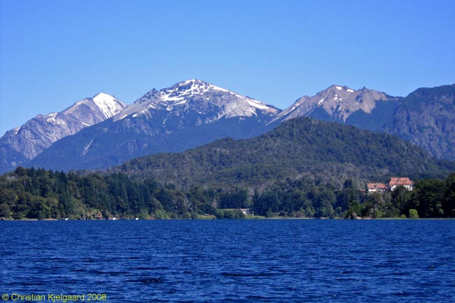 The five-star-plus Hotel Llao Llao, which you can see in the middle distance in this photograph, located on a narrow isthmus between Lago Moreno Oeste and Lago Nahuel Huapi and has incredible views all round of mountains and lakes. This photo was taken across Lago Moreno Oeste from the bridge that crosses the narrow channel between Lago Moreno Oeste and Lago Moreno Este