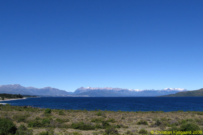 In the far distance you can see San Carlos de Bariloche and the mountains to its southwest and west. By this spot Route 237 you have crossed into Neuquén province from Rio Negro province, in which Bariloche is located. And yes, the sky really is this color. The air is very clean and clear in Patagonia