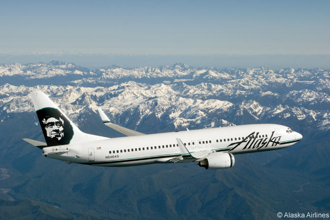 A Boeing 737-800 of Alaska Airlines flies over the mountains of Washington State