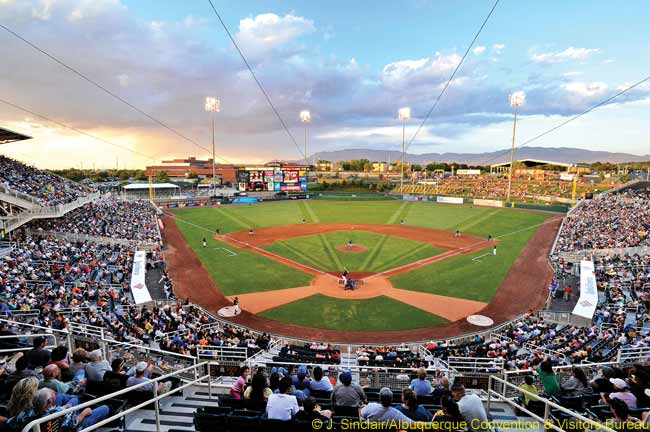 Baseball fans take in the view, including the Sandia Mountains in the background, at the AAA Albuquerque Isotopes Ballpark. With 310 days of sunshine, blue skies and a mild climate, Albuquerque's weather is good for outdoor activities year-round