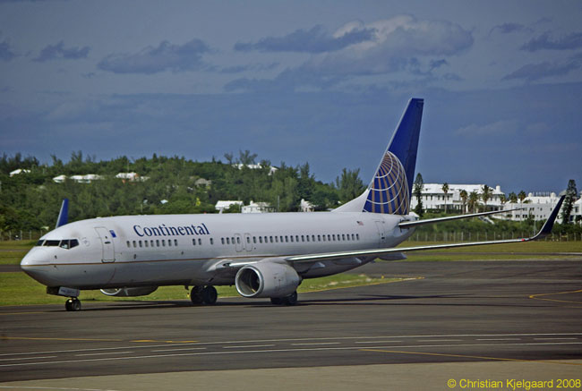 After landing, a Continental Airlines Boeing 737-800 taxis towards its ramp parking position at Bermuda L.F. Wade International Airport