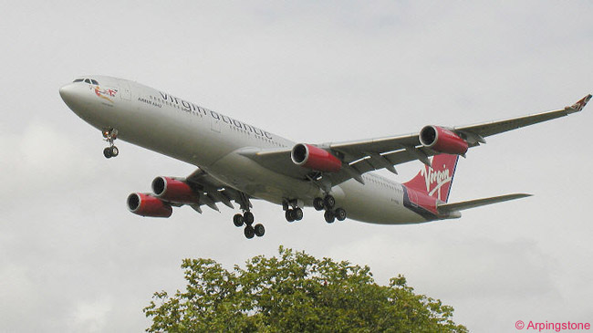 A Virgin Atlantic Airways Airbus A340 on short final at London Heathrow Airport