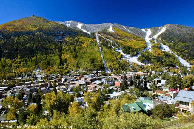 The town of Telluride in the San Juan Mountains in southwest Colorado is tucked within aspen trees and offers spectacular scenic views all year round