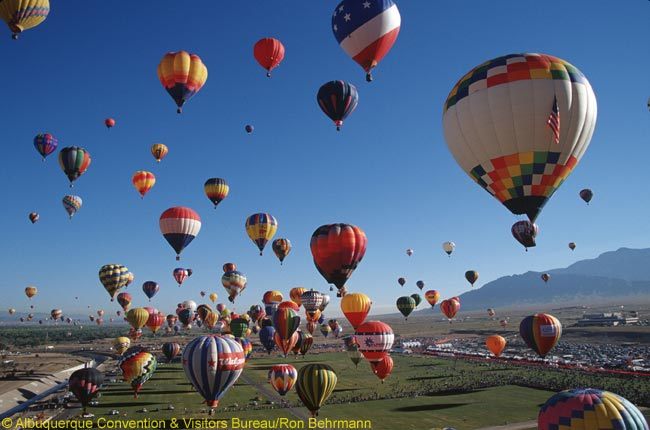 The annual Albuquerque International Balloon Fiesta sees thousands of visitors to the world's largest hot air ballooning event. More than 550 balloons dot the bright blue sky above the New Mexican high-desert landscape each fall. Photo by Ron Behrmann