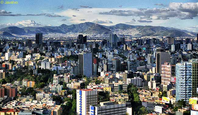 This is a view over Mexico City, which is situated in the Valley of Mexico in the high plateaus at the center of the huge country. Mexico City is one of the largest cities in the world and its greater metropolitan area is the world's third-largest