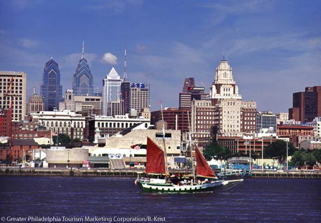 A view of Philadelphia from the Penn's Landing waterfront recreational area features vibrant activity on and next to the Delaware River. Penn's Landing's year-round attractions include the Independence Seaport Museum, free outdoor concerts and an ice skating rink. Photo by B. Krist for GPTMC