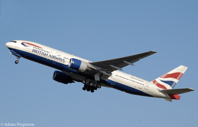 British Airways Boeing 777-200ER G-YMMD takes off from London Heathrow Airport, England. The undercarriage has just begun retraction