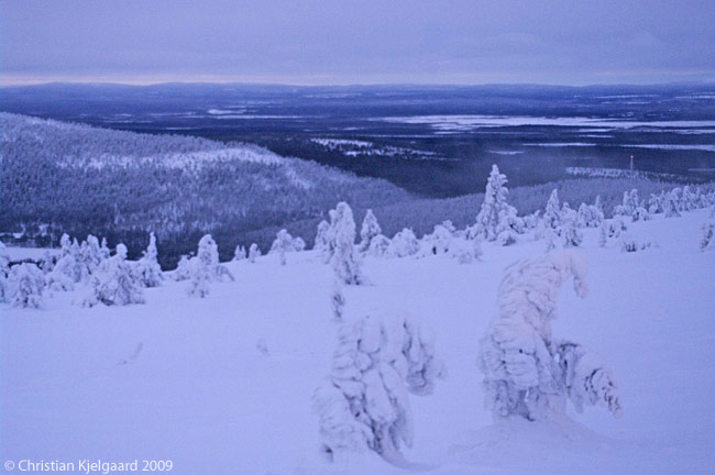 In winter twilight, which in December descends at around 2 p.m. in Lapland in the far north of Finland, the view from the top of Levi fell of the landscape of snow-covered forests, icebound lakes and distant fells is hauntingly beautiful. Levi lies some 150 kilometres above the Arctic Circle