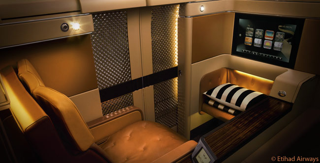 In Etihad Airways' first class cabins, each seat extends to a fully-flat bed that is 80.5 inches in length and each private suite is accessed by its own sliding door. The latest aircraft type in the Etihad Airways fleet to feature a first class cabin is the Airbus A330-300, the airline receiving in December 2009 the first of five A330-300s it has on order. Each of the frive will have 12 first class suites, as well as 40 business class seats and 151 economy class seats