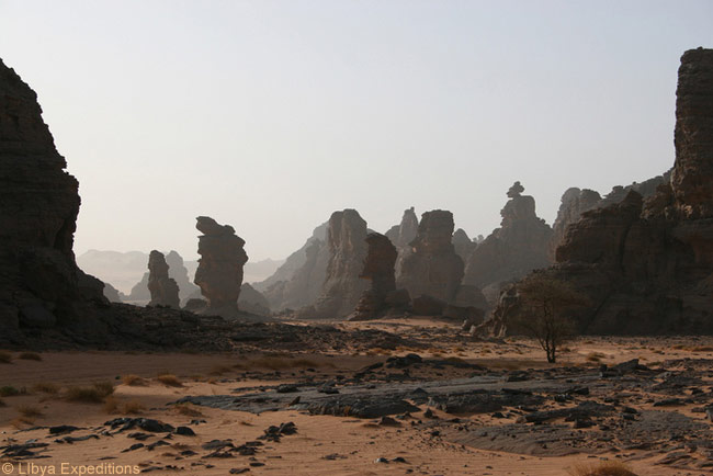 The Tadrart Akakus in Libya has bizarre rock formations, wadis, and cave art. These basalt monoliths are in the Tadrart Akakus, which is ove of Libya's five UNESCO World Heritage Sites