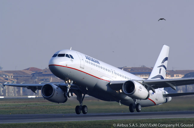 Aegean Airlines, Greece's largest airline at the time of the announcement on Februuary 22, 2010 of its proposed merger with Olympic Air, operated an all-jet fleet of 32 aircraft. Aegean's fleet included four Airbus A321-200s, 18 A320s, four soon-to-be-returned Boeing 737-400s and six Avro RJ100s. In this photograph, one of AZegfean's A321-200s takes off from Toulouse Blagnac airport, where most of the Airbus final-assembly lines are located