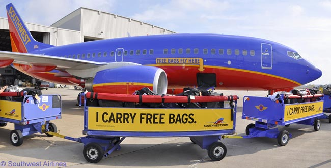 15b80bdd64a0 More than 50 of Southwest Airlines  Boeing 737s are being decorated with  decals that reinforce the airline s  Bags Fly Free  ...