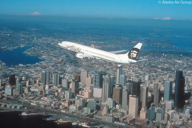 Alaska Airlines' all-Boeing 737 fleet includes 737-900s like this one photographed flying over Seattle, as well as 737-800s, 737-700s and half-freighter, half-passenger 737-400 Combis. The airline uses its 737-400 Combis for flights within Alaska. Alaska Airlines has also ordered 13 737-900ERs, which offer enough longer range than the basic 737-900 to allow transcontinental flights such as Seattle-Orlando