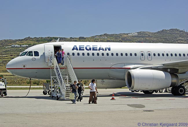 An Airbus A320 of Aegean Airlines disembarks its passengers at Mykonos National Airport, served by the carrier multiple times daily with 25-minute flights from Athens