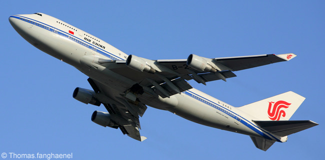 Air China Boeing 747-400 B-2443 climbs away from Beijing Capital International Airport