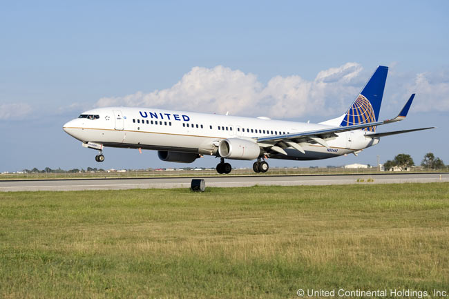 One of the first aircraft painted to reflect the merger of Continental Airlines and United Airlines to form United Continental Holdings is this Boeing 737-900, wearing the Continental livery but the United Airlines name under which the merged carriers ultimately will operate. The aircraft was painted in time for the announcement of the completion of the merger on October 1, 2010