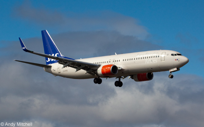 Scandinavian Airlines Boeing 737-883 LN-RRG is photographed on final approach to Lanzarote Airport in Spain's Canary Islands. SAS operates a total of 65 737NGs, among them 737-600s, 737-700s and 737-800s. The airline is one of the few operators of the 737-600 and with 28 in service has the world's largest fleet of the type