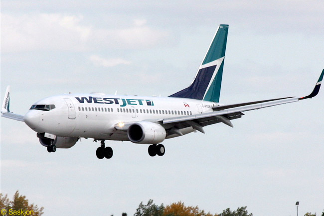 A Westjet 737-700 lands on Runway 31 at Regina International Airport in Saskatchewan