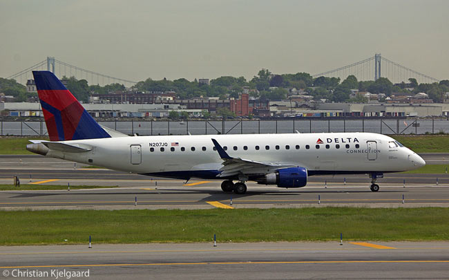 Embraer 175 N207JQ of Delta Connection carrier Shuttle America taxis out to the holding point for the take-off runway at New York LaGuardia Airport