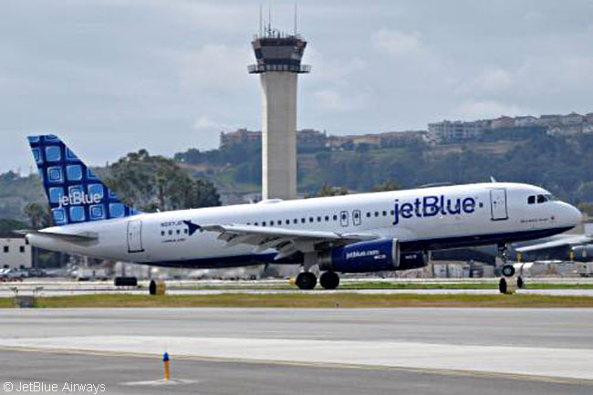 The Airbus A320 bearing JetBlue Airways' new 'Building Blocks' tailfin color scheme, designed by Long Beach staffer Troy Bokosky, takes off for Long Beach and its welcoming ceremony