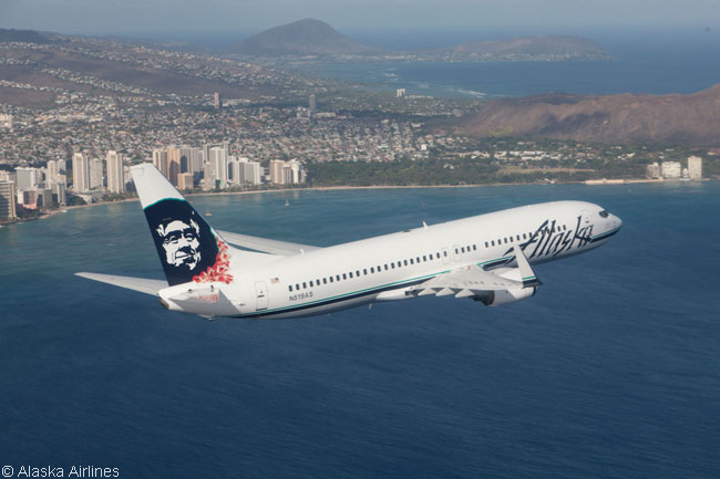 Alaska Airlines painted this Boeing 737-800 with a Hawaiian lei adorning its well-known Eskimo tail logo in honor of the airline's now-sizable network linking Alaska and the mainland U.S. with various destinations in the Hawaiian Islands. The aircraft is photographed here flying near Honolulu's famous Waikiki Beach
