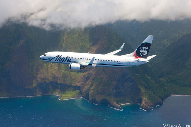Alaska Airlines painted this Boeing 737-800 to commemorate its growing route network to Hawaii. The aircraft is photographed over Molokai's sea cliffs