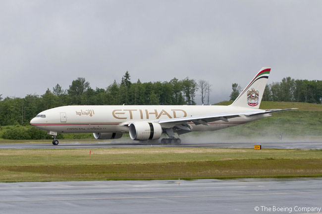 Boeing delivered Etihad Crystal Cargo's first 777 Freighter on June 23, 2011. Here the aircraft is pictured landing at Everett's Paine Field on a rainy Washington-state day