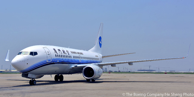At the beginning of August 2011, Xiamen Airlines took delivery of the 50th Boeing commercial jet directly ordered by the carrier. The milestone aircraft, a 737-700, incorporated both Boeing's High-Altitude/High-Temperature Airport Operations Feature Package and the new Boeing Sky Interior. Shown here is the 737-700 arriving at Xiamen Gaoqi International Airport