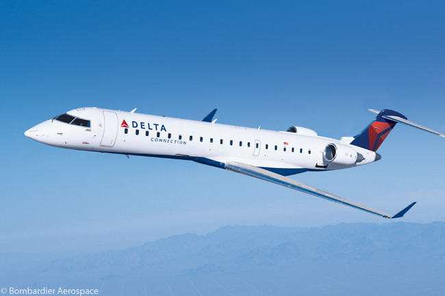 This is one of SkyWest Inc.'s Bombardier CRJ700s, many of which operate in Delta Connection service. All are fitted with 65 seats, including nine First Class seats and eight Economy Comfort seats, as well as in-flight Wi-Fi connectivity