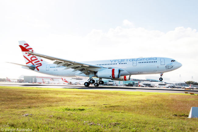 The A330 which was the first aircraft to show the Virgin Australia name and livery touches down at Sydney's Kingsford-Smith Airport on May 4, 2011, the day the Virgin Blue Group revealed its new identity