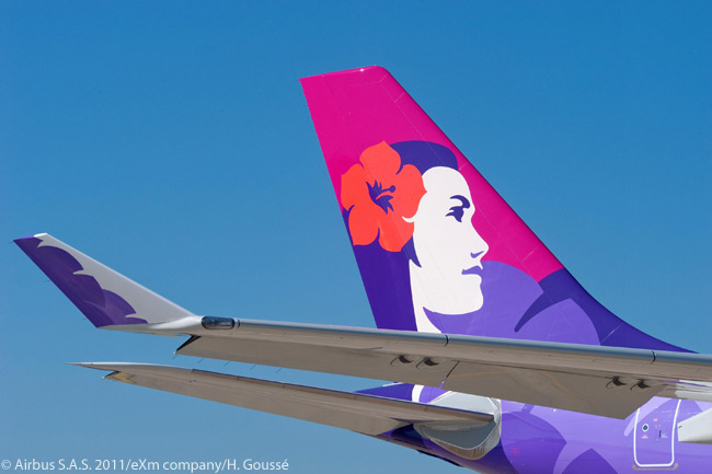 Hawaiian Airlines' livery is one of the most eye-catching and instantly recognizable of any airline's color schemes. This photo shows the tailfin and a winglet on one of Hawaiian's Airbus A330-200s