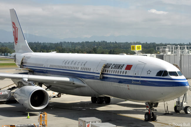 This photograph shows Air China A330-200 B-6505 loading at the gate at Vancouver International Airport