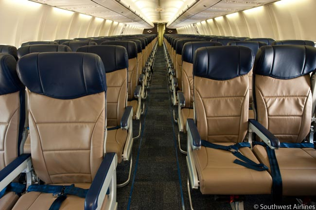 Southwest Airlines' new 'Evolve' cabin interior features recyclable carpet, a brighter color-scheme, and a more durable, eco-friendly, and comfortable low-profile seat that weighs less than the current seat. The new interior design also offers the airline greater revenue potential by increasing the number of seats onboard from 137 to 143