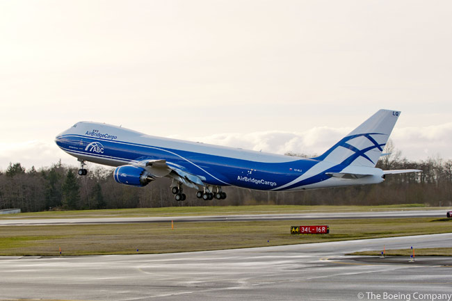 AirBridgeCargo, based in Russia and part of the Volga-Dnepr Group, took delivery of its first Boeing 747-8 Freighter on January 26, 2012. The aircraft, shown here taking off for a test flight from Paine Field in Everett, has a maximum structural payload capacity of 154 tons (140 tonnes) and provides 16 per cent more revenue cargo volume than the 747-400 Freighter