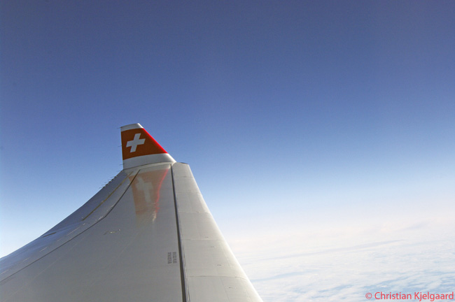 The Swiss flag emblem can clearly be seen on the winglet of this Swiss International Air Lines Airbus A330-300 as it cruises high over Western Europe. The airline has adopted the Swiss flag as its logo