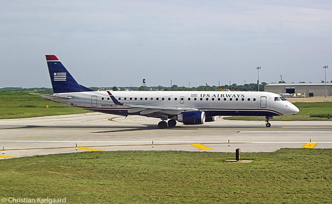 US Airways Embraer 190 N947UW begins its take-off run at Philadelphia International Airport