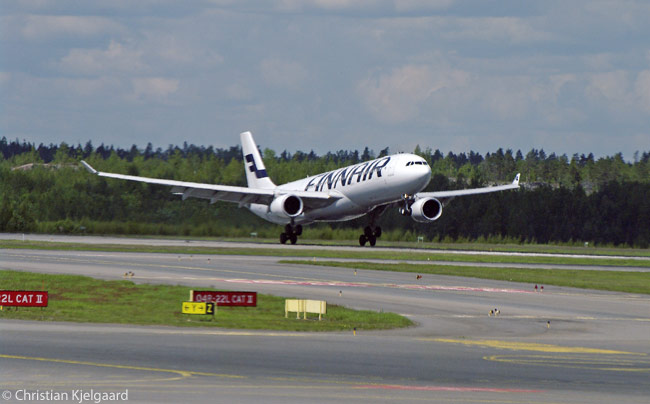 A Finnair Airbus A330-300 lands at Helsinki-Vantaa Airport on the afternoon of June 8, 2012, after completing a long-haul flight from Asia