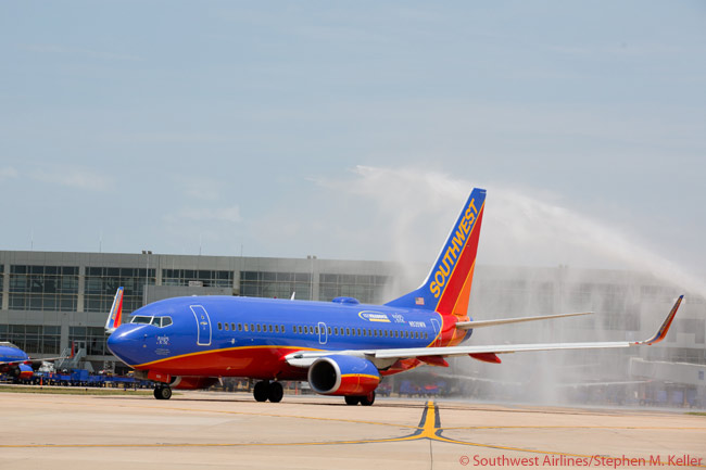 Southwest Airlines began service between Austin in Texas and Washington Reagan National Airport on July 9, 2012. In this photo, the aircraft operating the inaugural Austin-Washington National flight is given a water-cannon salute by the fire department at Auston-Bergstrom International Airport as the aircraft taxis out. On the same day, Southwest revealed it had bought four slots at Reagan National from another airline, in order to launch service between St. Louis and the near-downtown Washington airport in the fall of 2012