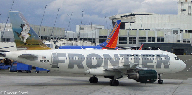 "This photograph shows Frontier Airlines Airbus A319 N933FR, with ""Sebastian the Hawk"" on its tail, at Seattle-Tacoma International Airport. Photograph by Razvan Socol. This file is licensed under the Creative Commons Attribution-Share Alike 3.0 Unported license"