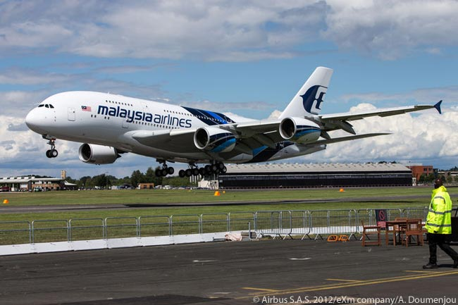 Malaysia Airlines' second A380 completes its flying display during the third day of the Farnborough International Airshow 2012