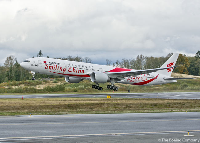 Air China's 10th Boeing 777-300ER, adorned with the distinctive 'Smiling Faces' livery, takes off from Paine Field Airport in Everett, Washington on October 30, 2012 on its delivery flight to Beijing