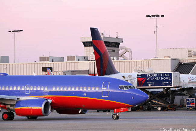 A Southwest Airlines Boeing 737-700 is photographed departing Hartsfield-Jackson Atlanta International Airport on February 12, 2012, the day Southwest began flying from the world's busiest airport