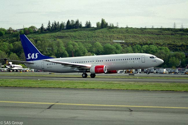 SAS Boeing 737-800 SE-DTK takes off from Boeing Field in Seattle