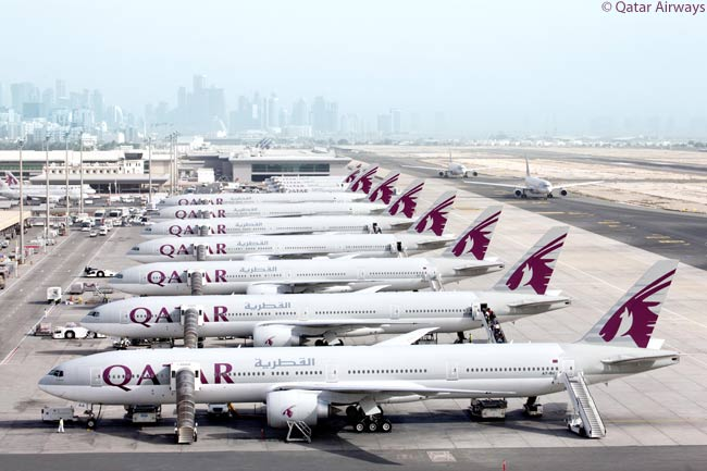 As of early 2013, Qatar Airways had in service or had ordered a total 25 Boeing 777-300ERs and was also operating nine Boeing 777-200LRs. In this photograph, seven of the carrier's 777-300ERs are seen lined up at its hub at Qatar's Doha International Airport