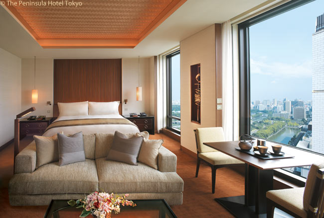 Modern and contemporary in design and featuring Japanese-inspired accents, each guestroom in The Peninsula Tokyo offers views of Hibiya Park or the Imperial Gardens. This photograph shows a Deluxe Park View Room