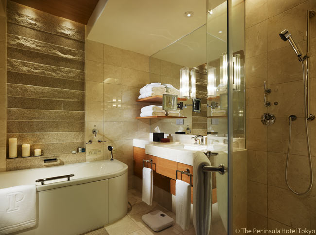 Each of the Peninsula Tokyo's deluxe guestrooms features a marble bathroom with double vanity, a telephone with hands-free function, mood lighting, a TV/radio and separate bath and rain shower
