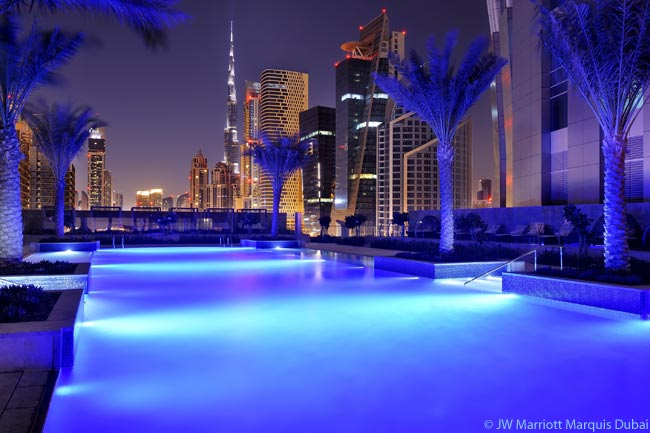 A pool deck covers the 7th floor of the JW Marriott Marquis Dubai and boasts a 30-meter (98-foot) swimming pool