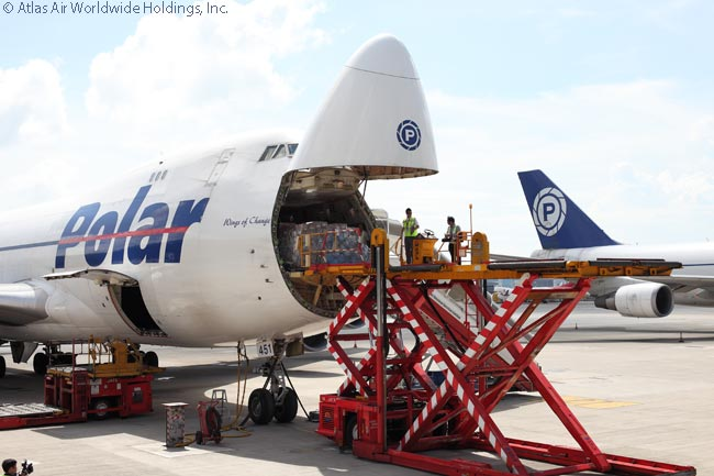 Atlas Air and Polar Air Cargo (both of which are owned by Atlas Air Worldwide Holdings) together operate the laregst fleet of Boeing 747 freighters in the world. This photograph shows two Polar Air Cargo 747-400Fs being loaded