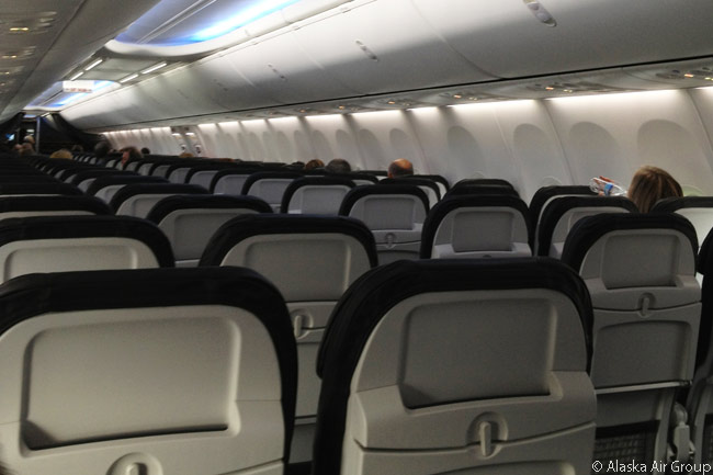 This is the cabin interior of an Alaska Airlines Boeing 737-900ER. According to the airline, travelers like the slimline Recaro seats in the airline's 737-900ERs so much that Alaska Airlines decided to fit the seats to its Boeing 737-800s and 737-900s, along with a new in-flight entertainment system. The refit has the not-coincidental benefit of allowing the cabin of each 737-800 to accommodate six more seats than previously, and each 737-900 to accommodate nine more seats