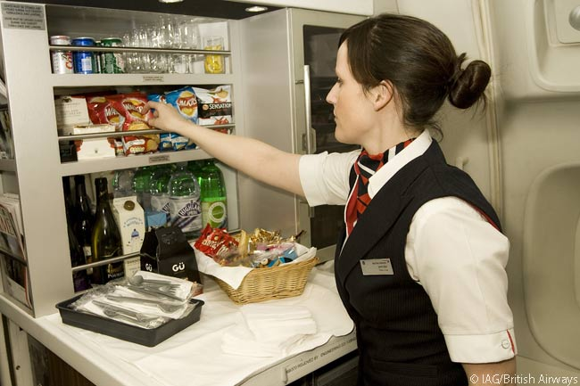 British Airways keeps a well-stocked kitchen in each of its long-haul Club World cabins, from which flight attendants can prepare trays of snacks to offer throughout the cabin or passengers can come and find snacks and beverages for themselves